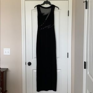 A vintage black sheer and sequin prom dress